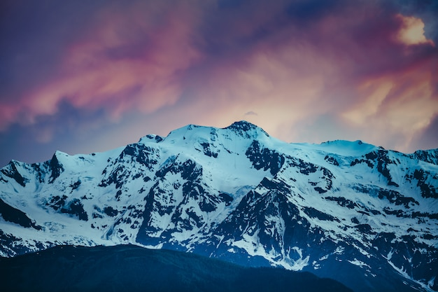 Sunset evening view over the snowy mountain range