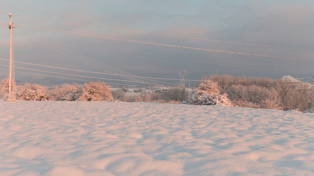 Sunset over a field covered in snow