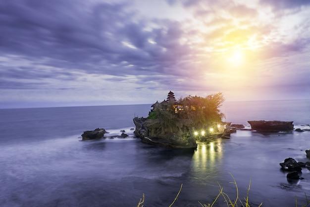 Sunset over hindu temple pura tanah lot bali indonesia