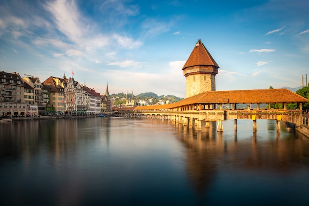Sunset in historic city center of lucerne with famous chapel bridge and lake lucerne in canton of lucerne, switzerland.