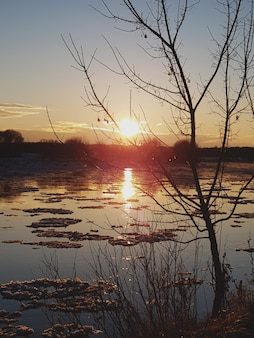 Sunset and ice on the river