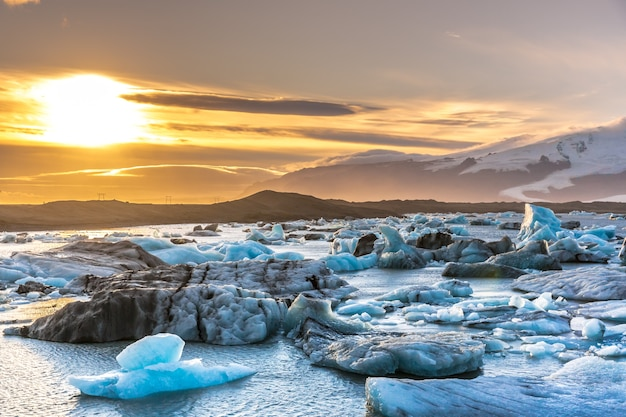 Sunset at the iceberg lagoon in iceland, snow cape mountains