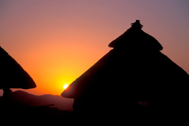 Sunset behind konso huts in ethiopia