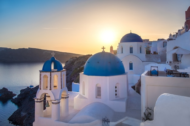 Sunset over local church in oia, santorini, greece