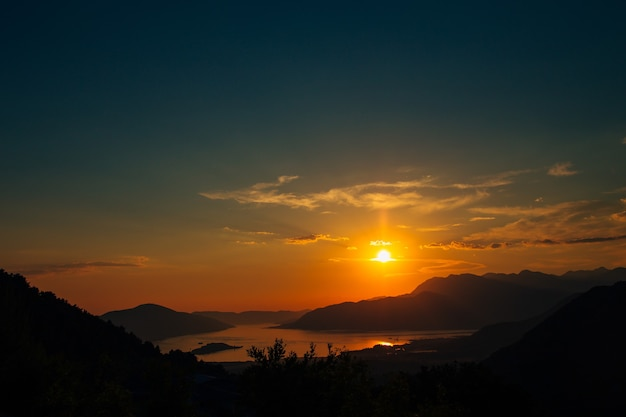 Sunset in montenegro over the mountains and the sea Premium Photo