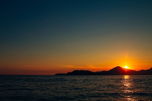 Sunset in montenegro over the mountains and the sea