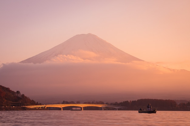 Sunset at mountain fuji with people in japan autumn season
