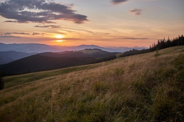 Sunset in the mountains landscape. overcast sky before storm. carpathian, ukraine, europe.