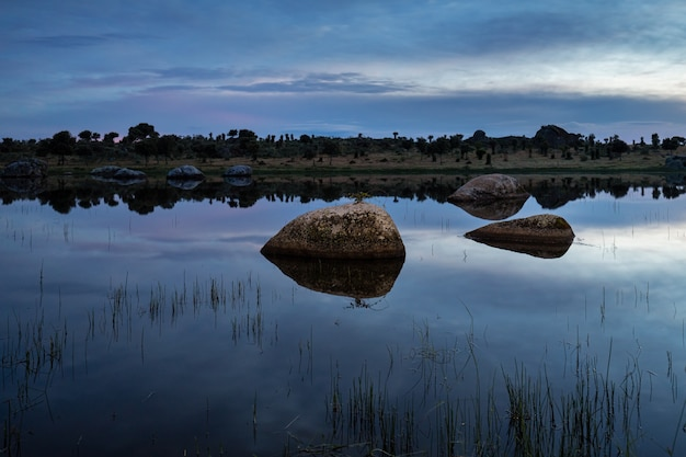 Sunset in the natural area of the barruecos. natural landscape with a lake