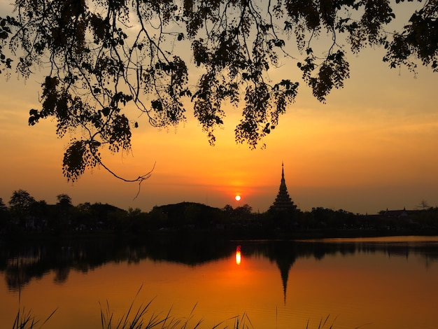 Sunset near the temple by the lake