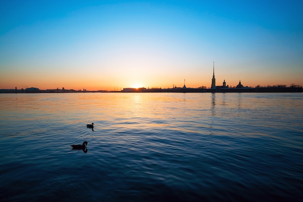 Sunset over the neva river on the background of peter and paul fortress. white night. saint-petersburg.