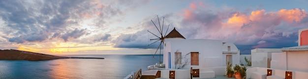 Sunset in oia village on santorini island, greece