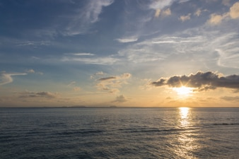 Sunset over the sea with blue sky