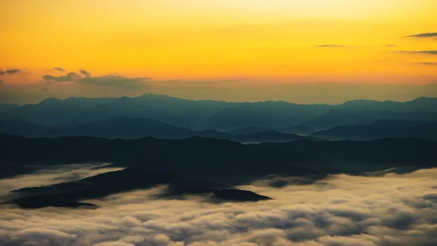 Sunset overlooking mountains with mist