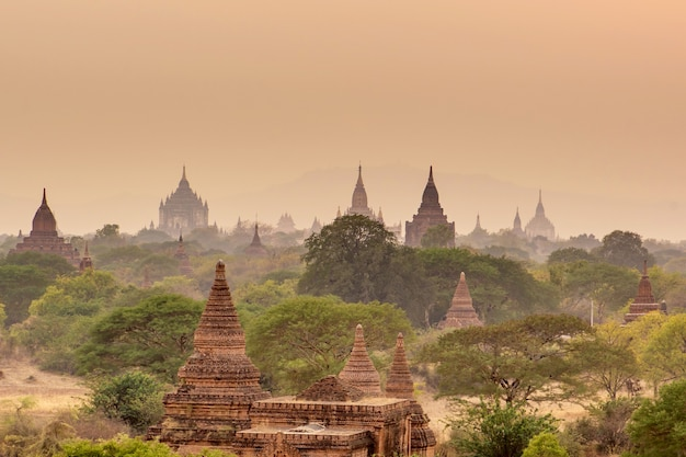 Sunset at pagoda landscape in the plain of bagan, myanmar