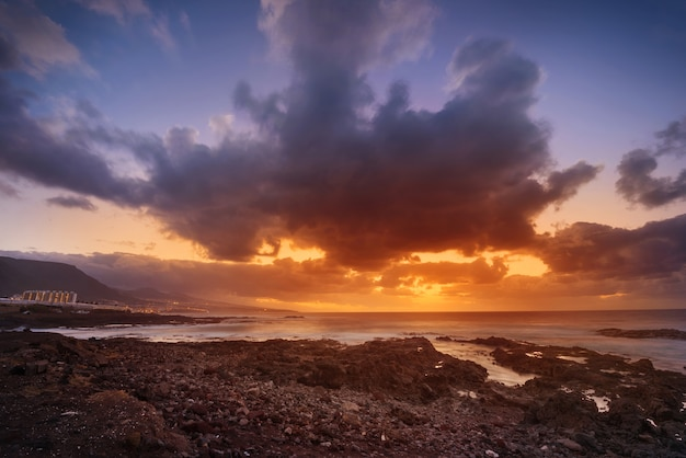 Sunset in punta del hidalgo, north tenerife coastline, canary islands, spain.