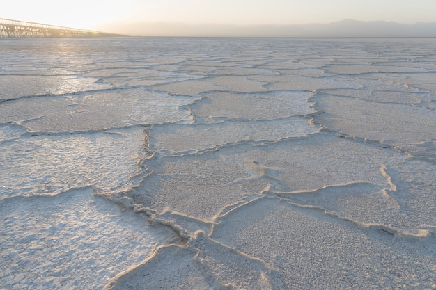 Sunset on the salt plains of asale lake in the danakil depression in ethiopia, africa.