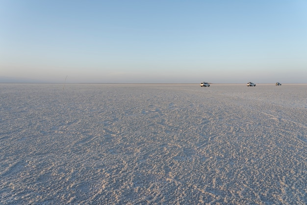 Sunset on the salt plains of asale lake in the danakil depression in ethiopia, africa