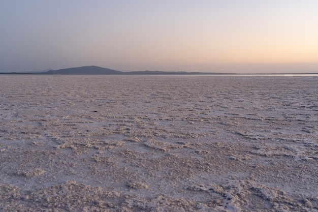 Sunset on the salt plains of asale lake in the danakil depression in ethiopia