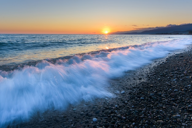 Sunset on sea. long-exposure waves.