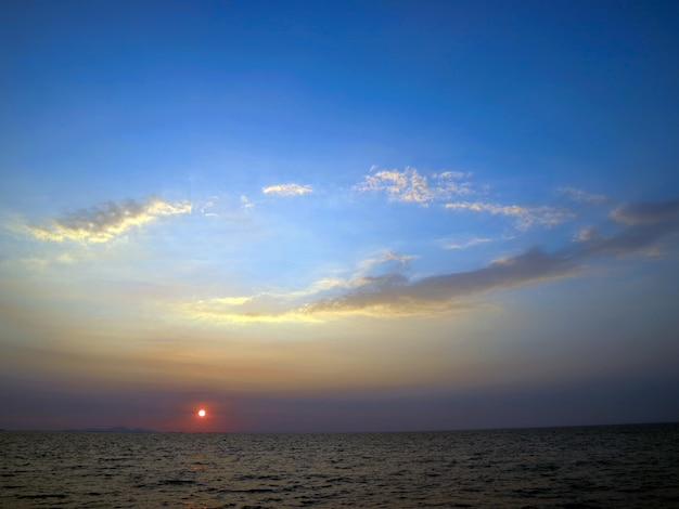 Sunset on the sea and oval cloud blue sky