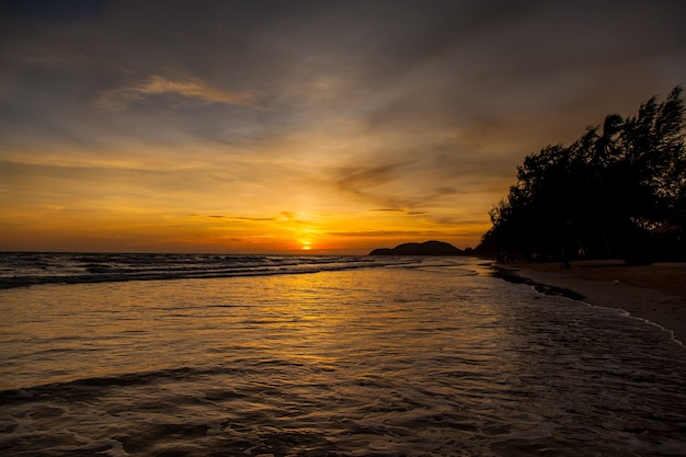 Sunset and sea waves, beautiful gold sunset on the sea