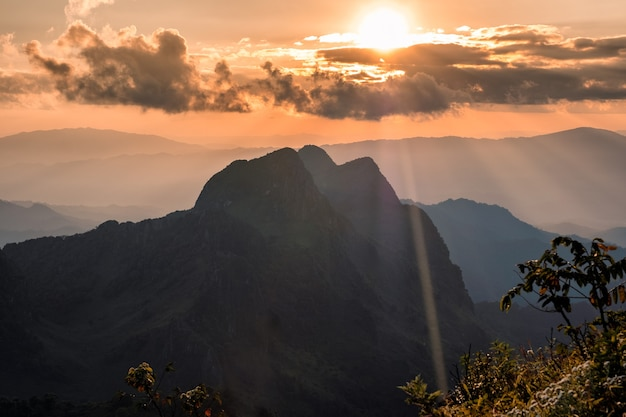 Sunset shining on mountain in wildlife sanctuary at  doi luang chiang dao, chiang mai, thailand