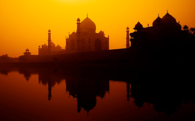 Sunset silhouette of a grand taj mahal