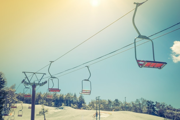Sunset and  ski lift going over the mountain ( filtered image pr