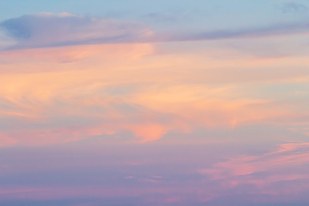 Sunset sky background with pink purple and blue dramatic colorful clouds vast sunset sky landscape