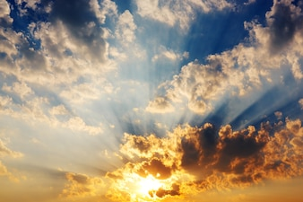 Sunset sky clouds with sun rays