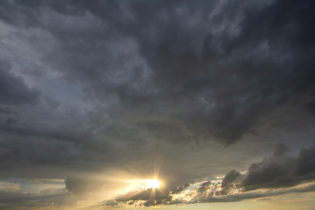 Sunset sky covered with dramatic storm puffy clouds before rain.