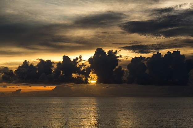 Sunset sky over the indian ocean, cloudy sunset in the tropics.