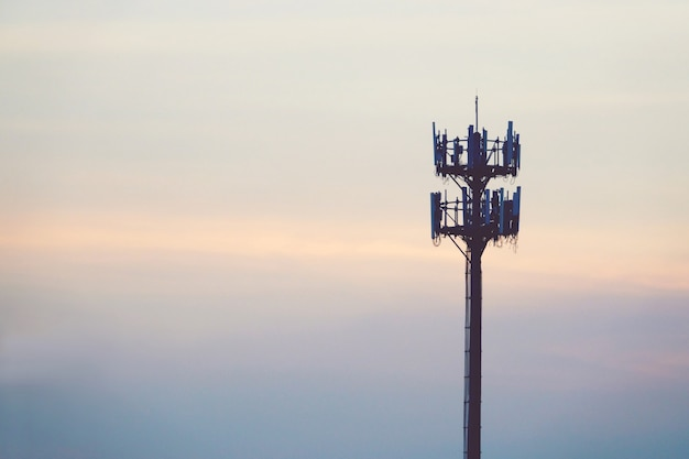 Sunset and tall mast with cellular antenna