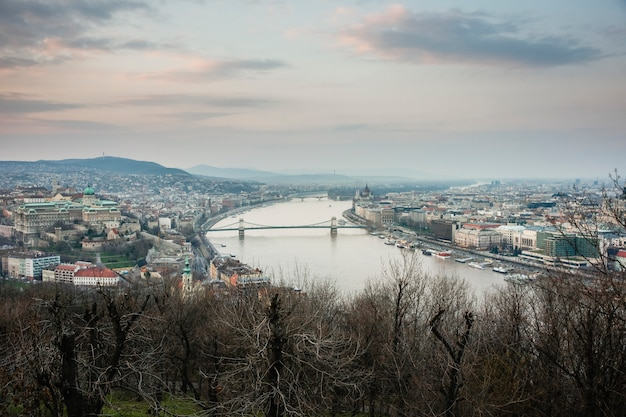 Sunset view of the city of budapest on a cloudy day.