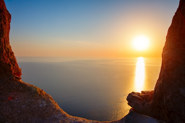 Sunset view from mountaintop. tourism, travel, sea background.