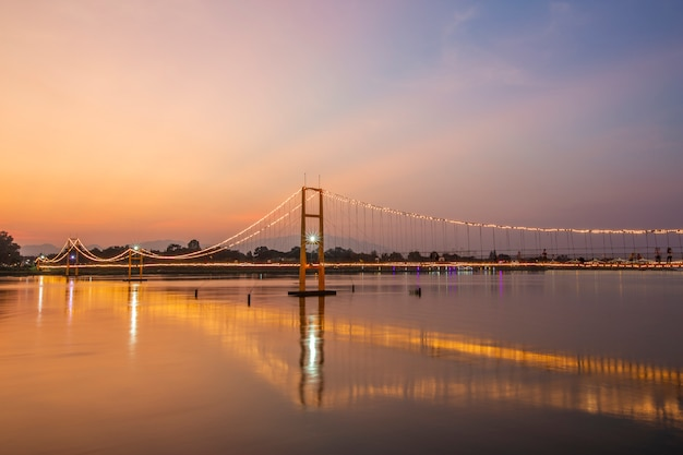 Sunset view of the golden gate bridge or 200 year rattanakosin sompoch bridge from tak, thailand.