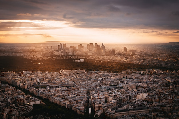 Sunset view to la denfense in paris, france
