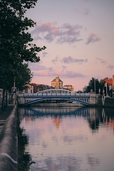 Sunset view of the liffey river captured together with the bridge