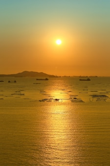 Sunset view overlooking koh sichang and cargo ship in sea