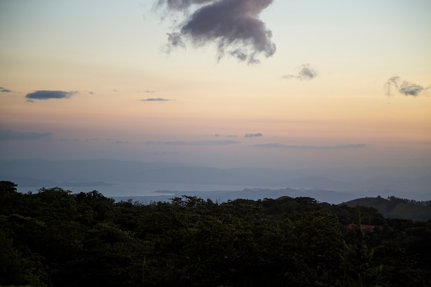 Sunset view of tropical rainforest in costa rica