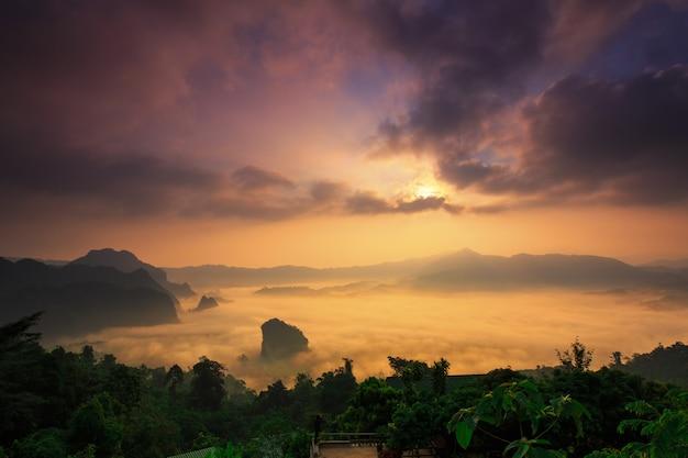 Sunshine and clouds on the morning mist at phu lang ka, phayao, thailand