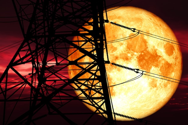 Super blood moon back silhouette power electric pole and night red cloud on sky