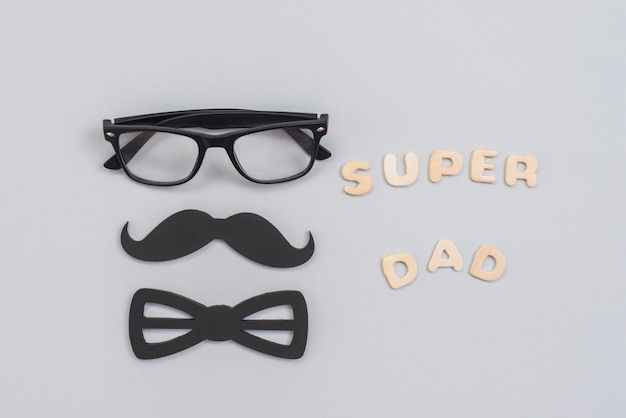 Super dad inscription with glasses and paper mustache