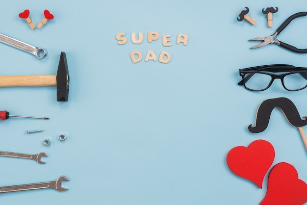 Super dad inscription with tools and glasses