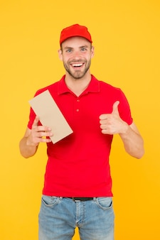 Super fast courier agent. service delivery. salesman career. courier and delivery. postman delivery worker. man red cap yellow background. delivering purchase. delivering happiness and needs.