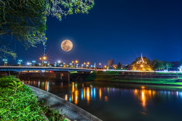 Super full moon over pagoda on the temple that is a tourist attraction