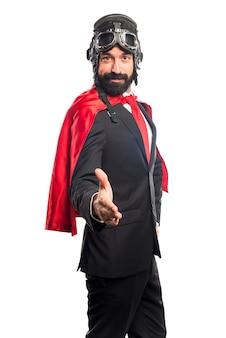 Super hero businessman making a deal