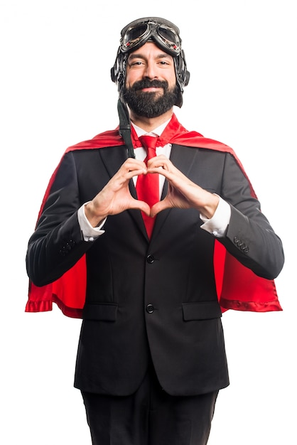 Super hero businessman making a heart with his hands