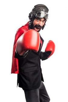 Super hero businessman with boxing gloves